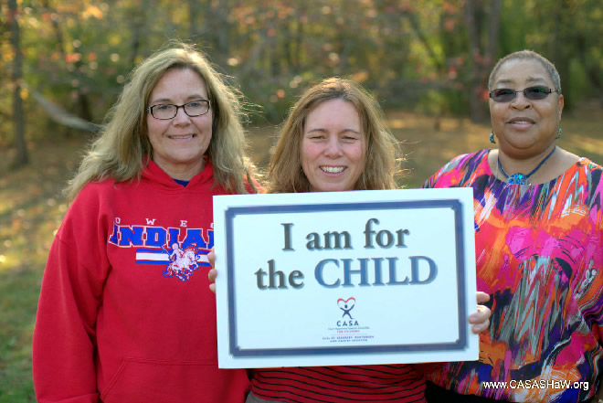 Marika Tracey (volunteer), Tracey Heisler, and Gayle Rodgers (trustee) promote the #iamforthechild campaign
